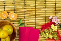 Flat lay holiday of Chinese new year red packet and of accessori. Es blossom on top and gold Lunar festival concept background, Other language means wealthy or royalty free stock photo