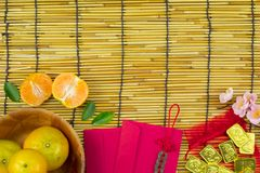 Flat lay holiday of Chinese new year red packet and of accessori. Es blossom on top and gold Lunar festival concept background, Other language means wealthy or stock images
