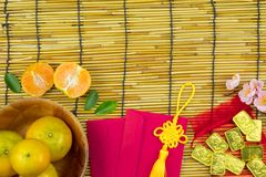Flat lay holiday of Chinese new year red packet and of accessori. Es blossom on top and gold Lunar festival concept background, Other language means wealthy or stock image