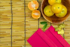 Flat lay holiday of Chinese new year red packet and of accessori. Es blossom on top and gold Lunar festival concept background, Other language means wealthy or royalty free stock photos