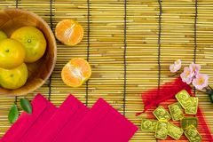 Flat lay holiday of Chinese new year red packet and of accessori. Es blossom on top and gold Lunar festival concept background, Other language means wealthy or stock photography