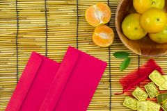 Flat lay holiday of Chinese new year red packet and of accessori. Es blossom on top and gold Lunar festival concept background, Other language means wealthy or royalty free stock photography