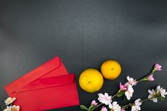 Flat lay holiday of Chinese new year red packet and of accessori. Es blossom on top and Lunar festival concept background, Other language means wealthy or rich stock photos