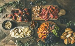 Flat-lay of holiday, party, family dinner table set with snacks. Flat-lay of holiday, party, family dinner table set with wine snacks. Meat, cheese, olives royalty free stock photos