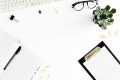 Home office desk. Women workspace clipboard, notebook, keyboard,. Flat lay home office desk. Women workspace with clipboard, notebook, keyboard, glasses Royalty Free Stock Image