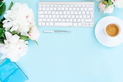 Flat lay home office workspace on blue Royalty Free Stock Photo