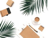 Flat Lay Home office workspace mockup with clipboard, tropical leaves stock image