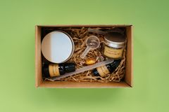 Flat lay of homemade  body and skin care creams. Flat lay of ingredients for homemade cosmetics, body and skin care creams on green background. Organic beauty Stock Photos