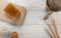 Flat lay honey and natural honeycomb royalty free stock images