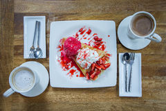 Flat lay hot drink cup and strawberry crepe dessert Royalty Free Stock Image