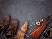 Flat lay with hunting ammunition over the grey background: old b stock photo