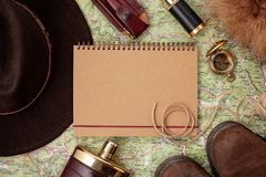 Flat lay with hunting ammunition over the map as background: old royalty free stock photography