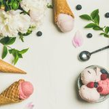 Flat-lay of ice cream scoops and peonies, square crop stock photos