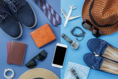 Flat lay image of accessory clothing man or women to plan travel in holiday. Background concept.Mobile phone & passport with items in vacation season.Table top royalty free stock photography