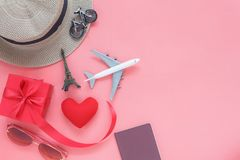 Flat lay image of accessory clothing man or women to plan travel in valentines. Day background concept.Passport & clothes with many items in holiday season royalty free stock photography