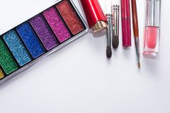 Flat lay image of beauty cosmetics make up with lipsticks, eye shadow palette, brushes, lip gloss. Top view with copy space, for royalty free stock photography