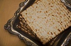 Flat Lay image of Jewish Matzoh on Silver Plate Stock Photo