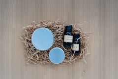 Flat lay of homemade  body and skin care creams. Flat lay of ingredients for homemade cosmetics, body and skin care creams on carton background. Organic beauty Royalty Free Stock Photography