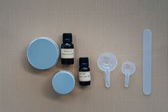 Flat lay of homemade  body and skin care creams. Flat lay of ingredients for homemade cosmetics, body and skin care creams on carton background. Organic beauty Stock Photography