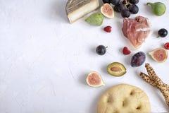 Flat Lay italian wine appetizer Fig Grape Plum Raspberry stock photo