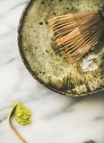 Japanese tools and bowls for brewing matcha tea, marble background. Flat-lay of Japanese tools for brewing matcha tea. Matcha powder in tin can, Chashaku spoon Royalty Free Stock Photos