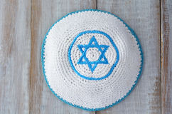 Flat lay of a Knitted kippah with embroidered blue and white Sta Royalty Free Stock Images