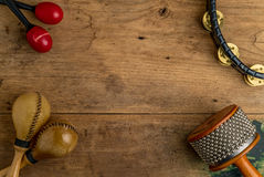 Flat lay of Latin percussion on wood desk Royalty Free Stock Images