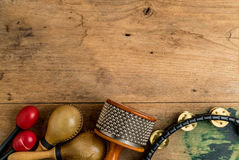 Flat lay of Latin percussion on wood desk stock images