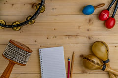 Flat lay of Latin percussion on wood desk stock image