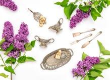 Flat lay with lilac flowers. Coffee tea cake Stock Photos