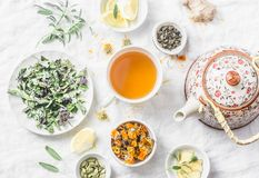 Flat lay liver detox antioxidant tea, teapot and the ingredients for it on a light background, top view. Herbal homeopathic recep royalty free stock photography
