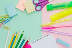Flat lay lots of stationery on mint pink background, pens, stick stock image
