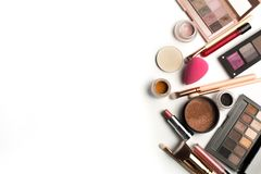 Flat lay of makeup palettes, eyeshadow pigments and lip gloss. S stock photo