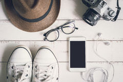 Flat lay of men casual fashion outfits on wooden background. Top view Royalty Free Stock Images