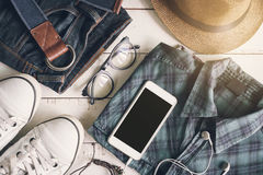 Flat lay of men casual fashion outfits on wooden background. Top view Stock Photos