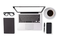 Flat lay of men device accessories in black tone color on office desk table such as notebook laptop computer , cup of coffee royalty free stock images