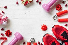 Flat lay of Merry Christmas and Happy new year and any holidy pr. Esent boxes for healthy and active lifestyle concepts. Composition with dumbbells, sport shoes Stock Photography
