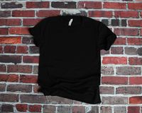 Flat lay mockup of black shirt on brick background for product m stock images