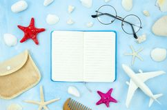 Flat lay mockup opened notepad framed with glasses, seashells and beach accessories. Summer frame with copy space.  stock photos