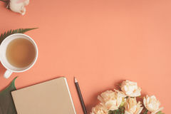 Free Flat Lay Notebook And Rose Placed On A Red Desk Royalty Free Stock Images - 97420459