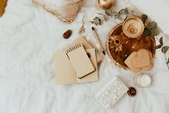 Flat lay with notebook and gold decorations. royalty free stock photo