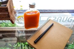 Flat lay of notebook pen and beverage in restaurant stock photo