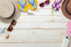 Flat lay objects the accessory for travel summer holiday background concept. Table top view of fashion man & woman clothing to traveler at beach trip on modern royalty free stock photography