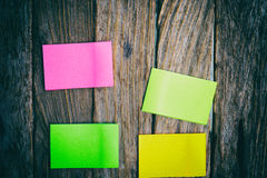 Flat Lay Of Office Supplies - Colorful Sticky Notes On Wooden Bo Royalty Free Stock Image