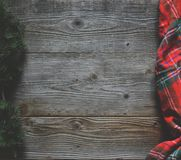 Flat Lay Of Scarf With Christmas Tartan Texture And Branch Of Tree On Wooden Background With Space In Middle - Christmas Or New Royalty Free Stock Photos