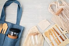 Free Flat Lay Of Zero Waste Kit. Set Of Eco Friendly Bamboo Cutlery, Mesh Cotton Bag, Reusable Coffee Tumbler, Brushes And Water Bottle Royalty Free Stock Image - 180254946