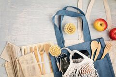 Free Flat Lay Of Zero Waste Kit. Set Of Eco Friendly Bamboo Cutlery, Mesh Cotton Bag, Reusable Coffee Tumbler, Brushes And Water Bottle Stock Photo - 180255410