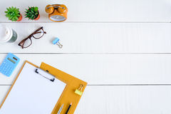Flat lay office equipment on a white wood desk Stock Images