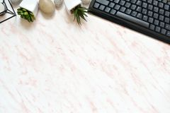 Flat lay office marble desk with phone, keyboard and notebook copy space background. Mock up template stock photography