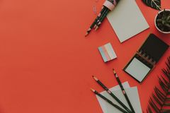 Flat Lay Office supplies on red background. stock images